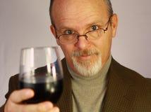 Hombre con el vidrio de vino Imagenes de archivo