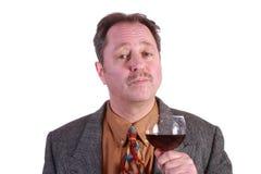 Hombre con el vino rojo Imagen de archivo libre de regalías