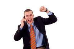 Hombre con ganar del teléfono móvil Imagen de archivo libre de regalías