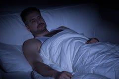 Hombre con insomnio Imagen de archivo libre de regalías