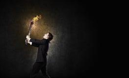 Hombre con la antorcha Foto de archivo libre de regalías
