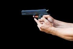 Hombre con la arma de mano aislada en negro imagenes de archivo
