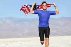 Hombre con la bandera americana - los E.E.U.U. del atleta del corredor foto de archivo libre de regalías