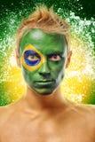 Hombre con la bandera del Brasil pintada en cara Imagen de archivo libre de regalías