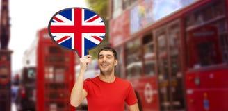 Hombre con la burbuja del texto de la bandera británica en Londres Imagen de archivo