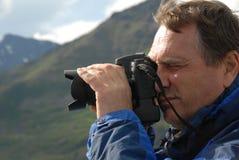 Hombre con la cámara Imagen de archivo libre de regalías