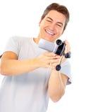 Hombre con la cámara de vídeo Fotografía de archivo libre de regalías