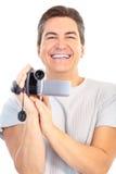 Hombre con la cámara de vídeo Imagen de archivo libre de regalías