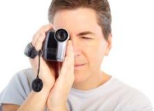 Hombre con la cámara de vídeo Fotos de archivo libres de regalías