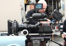 Hombre con la cámara del cine Imagen de archivo libre de regalías