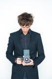 Hombre con la cámara media del formato Foto de archivo libre de regalías