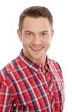 Hombre con la camisa de tela escocesa roja Imagen de archivo libre de regalías