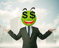 Hombre con la cara del smiley de la muestra de dólar Foto de archivo
