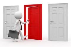 Hombre con la cartera que entra en una puerta roja Fotos de archivo libres de regalías