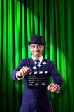 Hombre con la chapaleta de la película Imagen de archivo