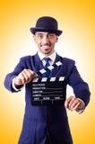 Hombre con la chapaleta de la película Fotografía de archivo