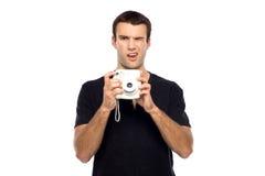 Hombre con la cámara instantánea Foto de archivo libre de regalías