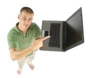 Hombre con la computadora portátil Imágenes de archivo libres de regalías