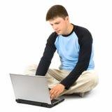 Hombre con la computadora portátil Fotografía de archivo libre de regalías