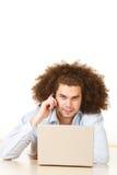 Hombre con la computadora portátil y el móvil Fotos de archivo libres de regalías