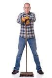 Hombre con la escoba Imagen de archivo libre de regalías