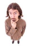 Hombre con la expresión facial divertida Foto de archivo libre de regalías