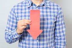 Hombre con la flecha que señala al plumón Foto de archivo