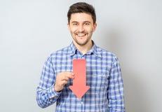 Hombre con la flecha que señala al plumón Fotografía de archivo libre de regalías