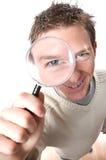 Hombre con la lupa Imagen de archivo libre de regalías