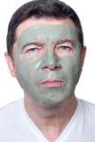Hombre con la máscara de la belleza foto de archivo libre de regalías