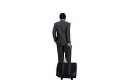 Hombre con la maleta en el fondo blanco Fotos de archivo libres de regalías