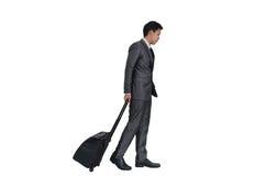 Hombre con la maleta en el fondo blanco Imagenes de archivo