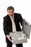 Hombre con la maleta llena de dinero Imagenes de archivo