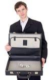 Hombre con la maleta que contiene el dólar Imagen de archivo libre de regalías