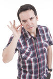 Hombre con la mano en el oído Imagen de archivo libre de regalías