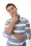 Hombre con la mano en la barbilla Imagen de archivo libre de regalías