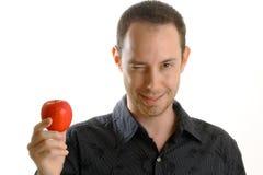 Hombre con la manzana Foto de archivo libre de regalías