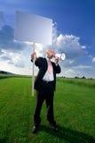 Hombre con la muestra y el megáfono Fotos de archivo libres de regalías