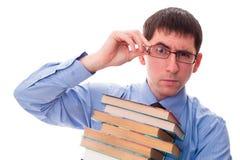 Hombre con la pila de libros Fotografía de archivo libre de regalías
