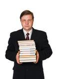 Hombre con la pila de libros fotos de archivo