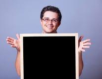 Hombre con la pizarra. Imágenes de archivo libres de regalías