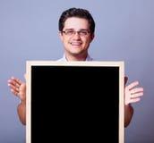 Hombre con la pizarra. Fotos de archivo