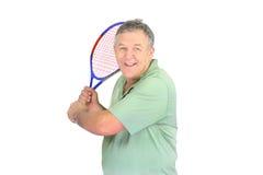 Hombre con la raqueta de tenis Foto de archivo libre de regalías
