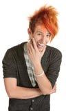 Hombre con la risa claveteada del pelo Imágenes de archivo libres de regalías