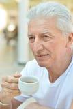 Hombre con la taza de café Fotografía de archivo