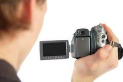 Hombre con la videocámara a disposición de la parte posterior Foto de archivo