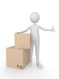Hombre con las cajas de cartón que muestran los pulgares para arriba Imágenes de archivo libres de regalías