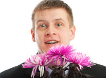 Hombre con las flores Imagen de archivo libre de regalías