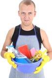 Hombre con las fuentes de limpieza Foto de archivo libre de regalías