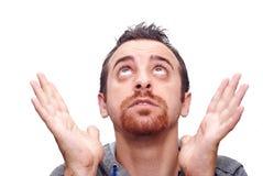 Hombre con las manos abiertas y la mirada para arriba Imágenes de archivo libres de regalías